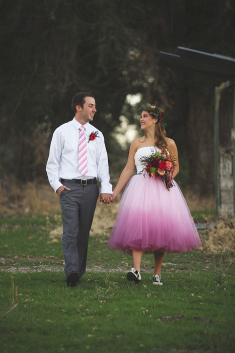 bride and groom walking on the farm