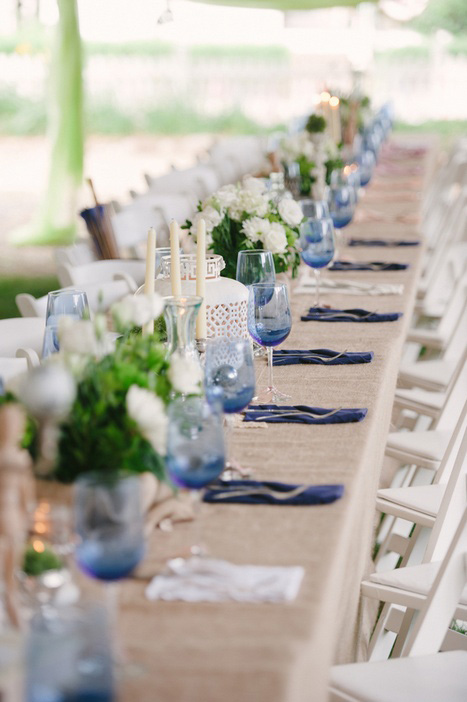 long wedding table covered in burlap