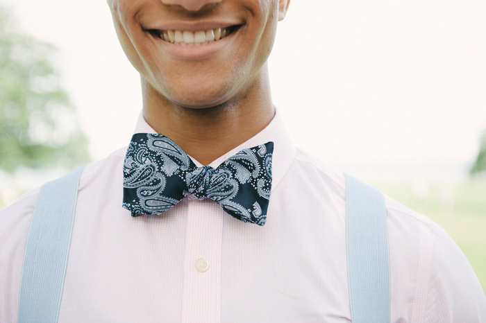 groom in blue paisley bow tie