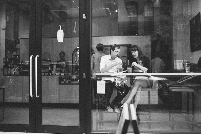 bride and groom at NYC cafe after elopement