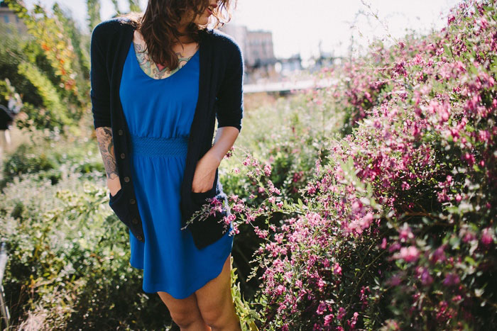 bride in blue dress and cardigan