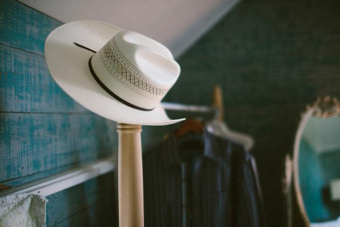 groom's cowboy hat