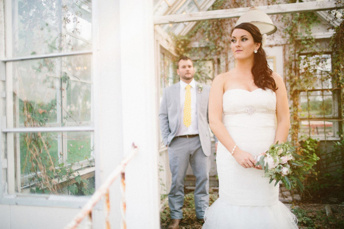 bride standing in doorway of greenhouse
