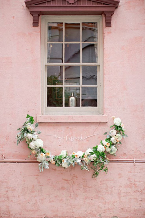 flower-garland-on-pink-wall