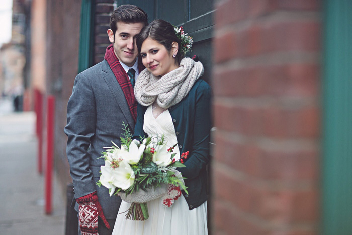 bride and groom in winter coats and scarves