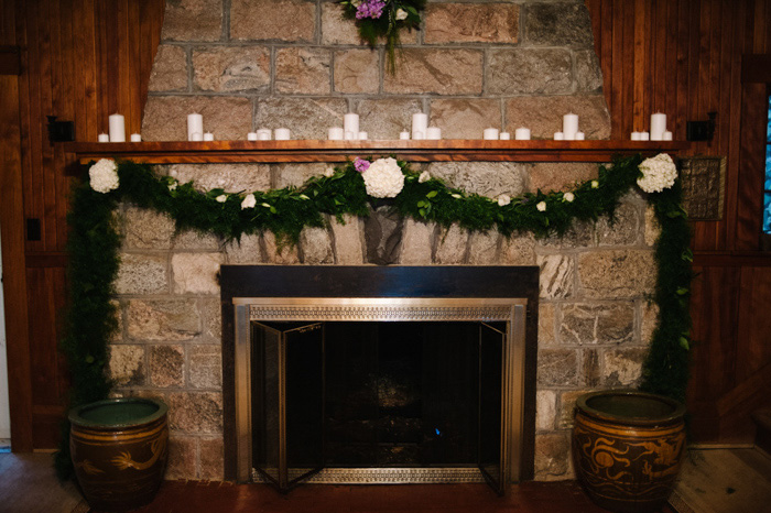 wedding altar in front of fireplace
