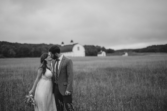 black and white wedding portrait in a field