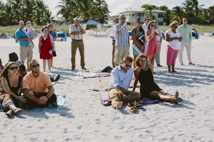 wedding guests on the beach
