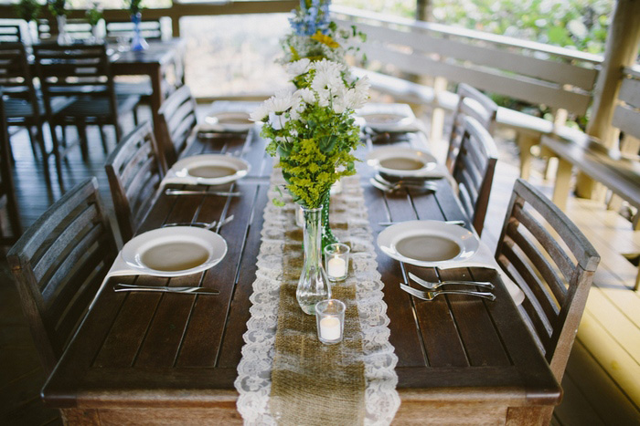 table set with burlap and lace runner