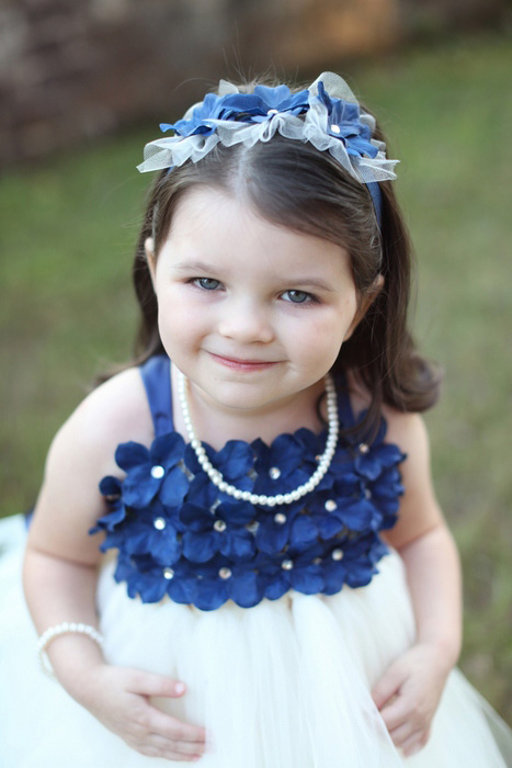 flower girl in blue flower dress
