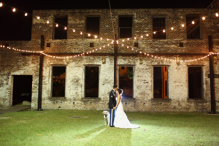 bride and groom under twinkle lights