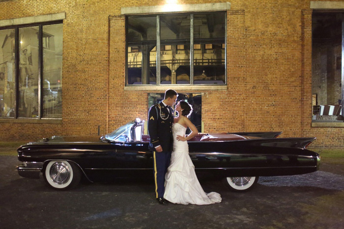bride and groom with vintage convertible