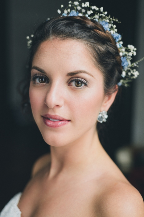bride with crown braid and flowers