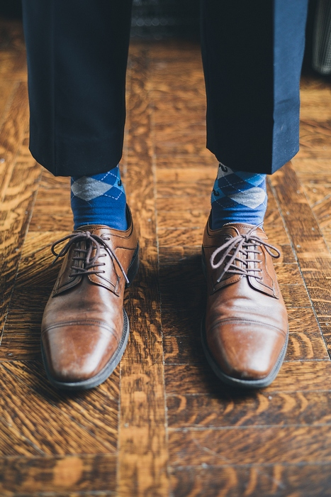 groom in blue argyle socks