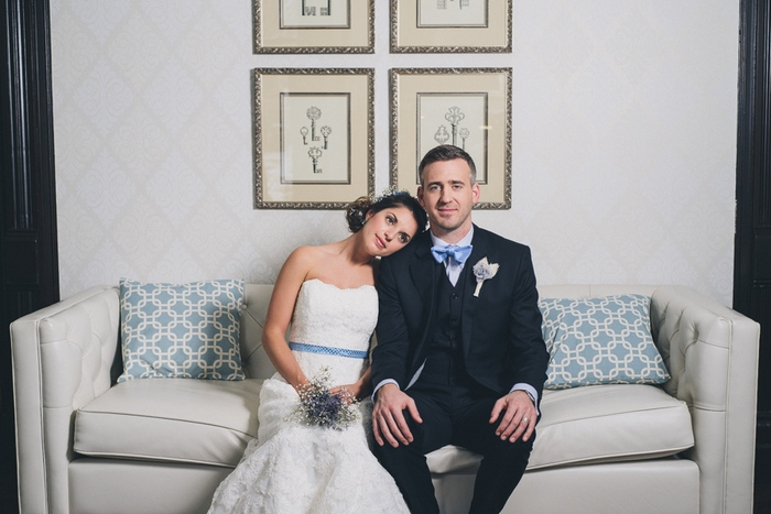 bride and groom on the couch