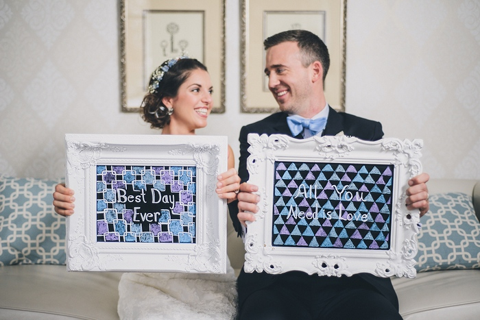bride and groom with framed art