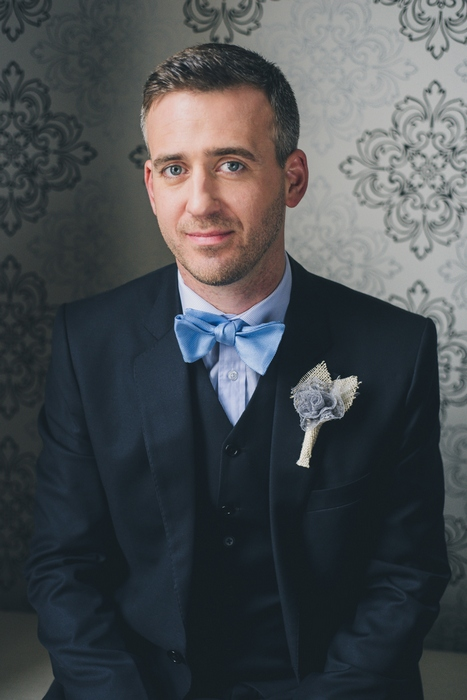 groom in pale blue bow tie