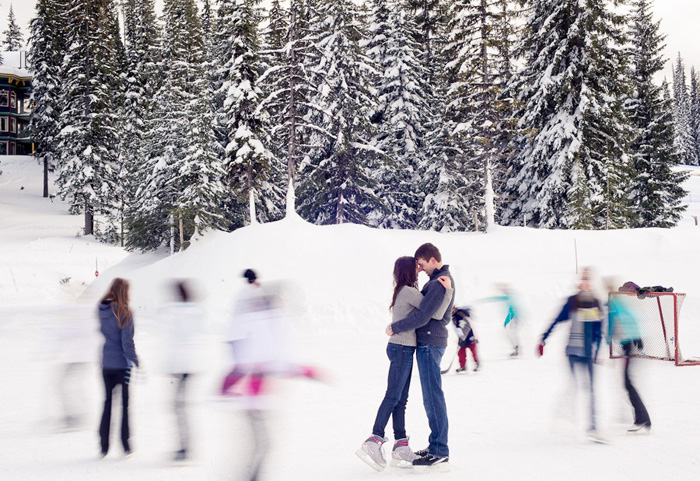 couple kissing on skating rink