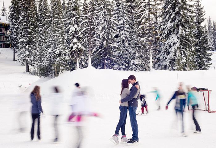 couple kissing on skating rink
