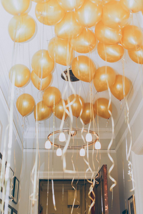 ceiling full of gold balloons