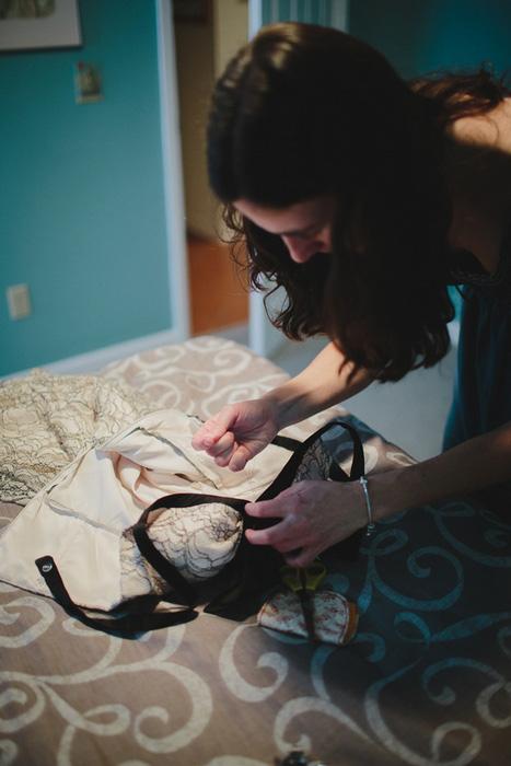 bride mending her dress