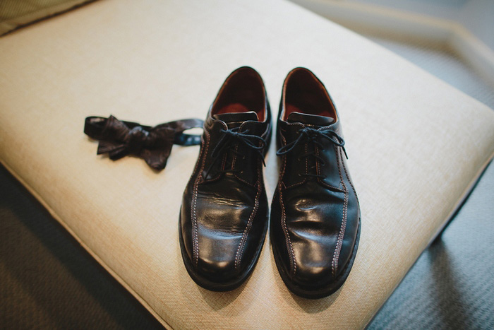 groom's shoes and bow tie