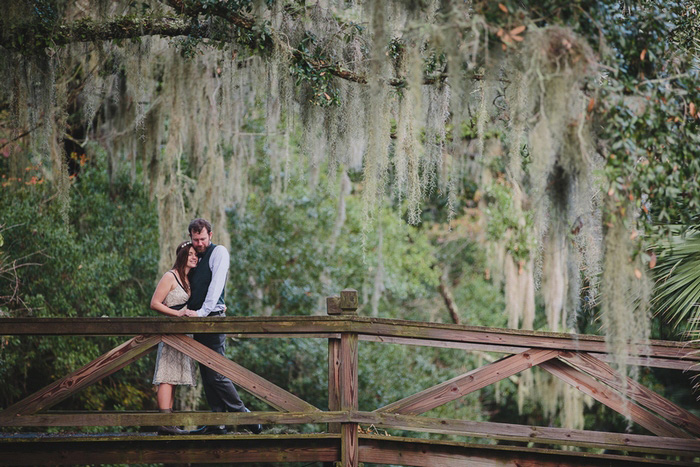 bride and groom on wooden bridge