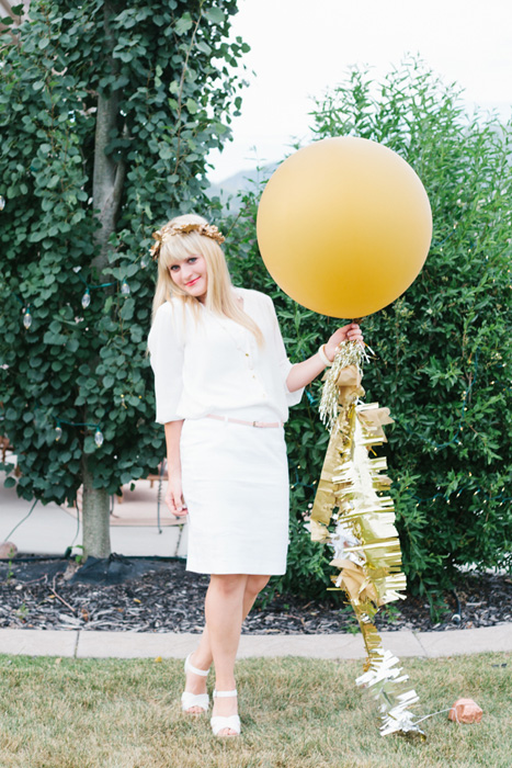 gold balloon with gold tassles