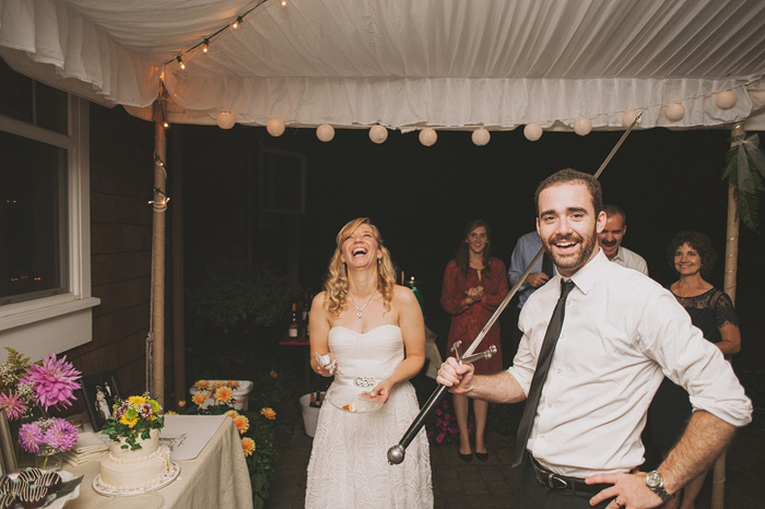 groom with cake cutting sword