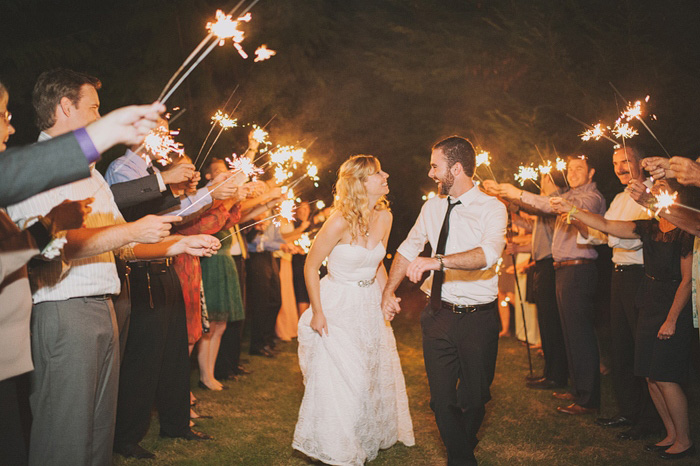 bride and groom running through sparkler send-off