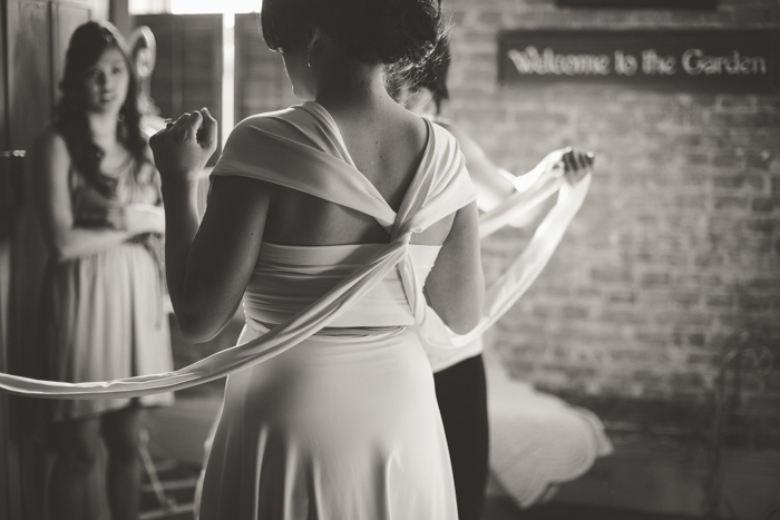 bride tying her dress