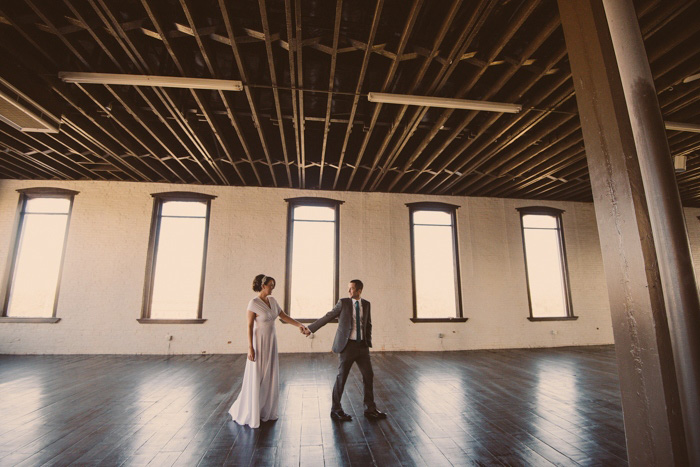 bride and groom in Texas loft