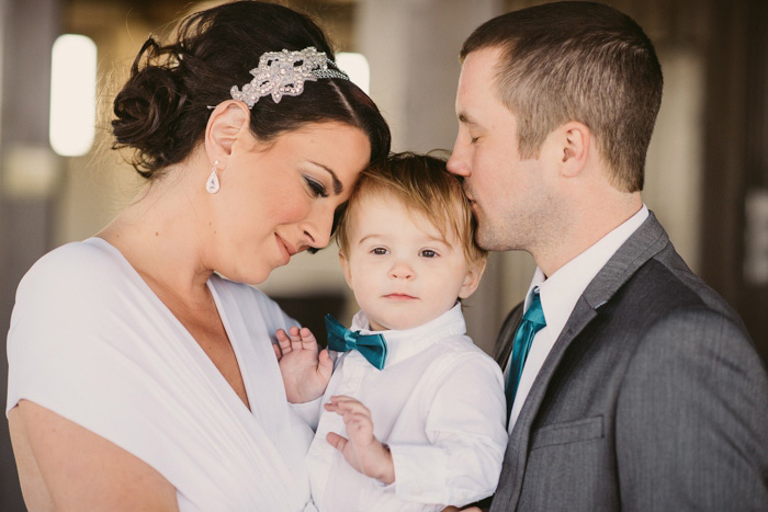 bride and groom with baby son