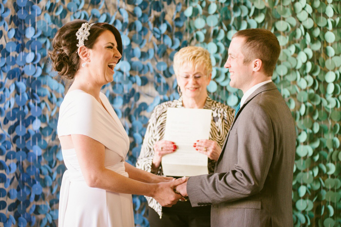 bride and groom laughing during ceremony
