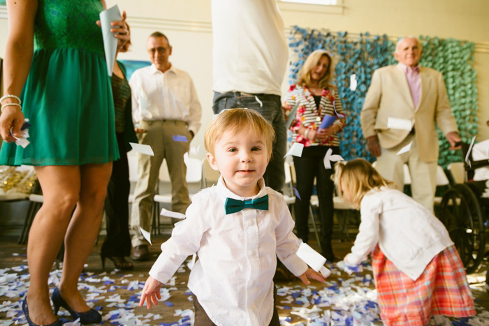 toddler playing in confetti