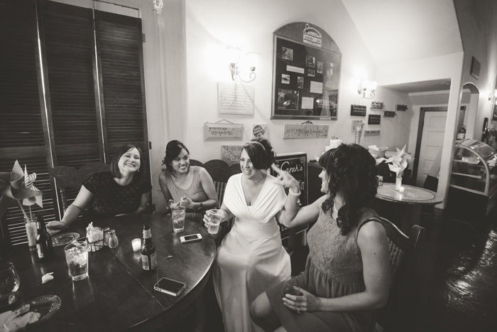 bride chatting with guests at wedding reception