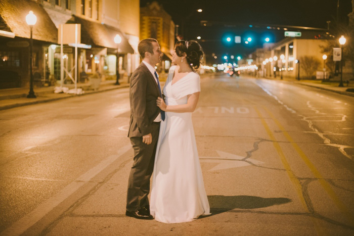 bride and groom portrait in the street