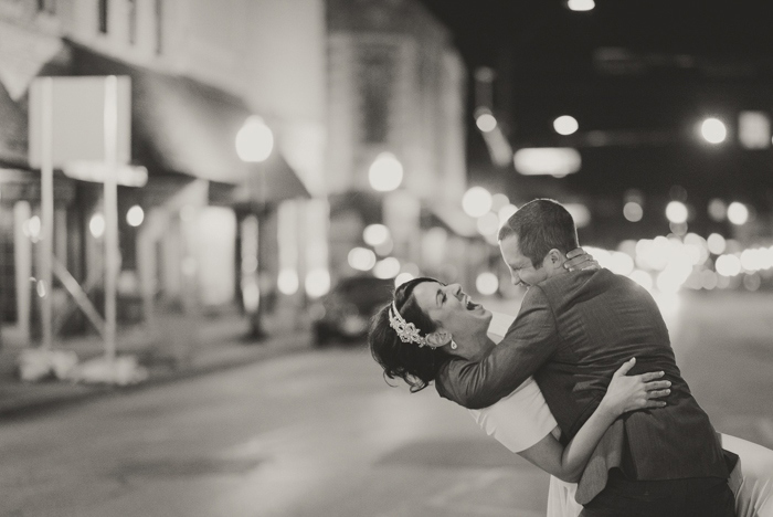 groom dipping bride in the street