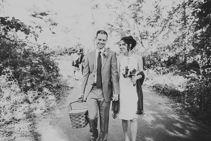 bride and groom with picnic basket