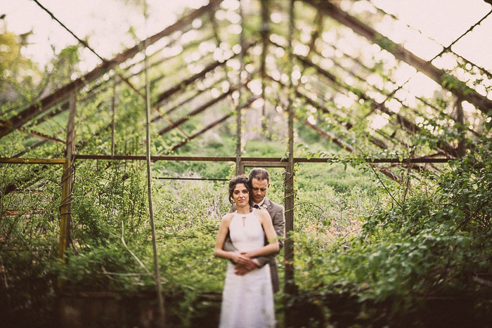 bride and groom in abandoned greenhouse