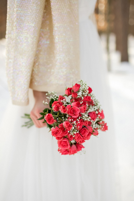 winter bride with red rose bouquet