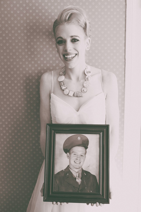 bride with vintage photograph of her grandfather