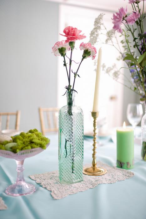 carnations in vintage blue glass vase