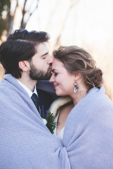 cozy bride and groom winter portrait