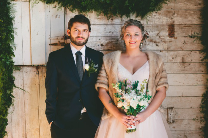 bride and groom on winter porch