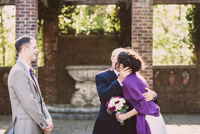 bride kissing father at wedding ceremony