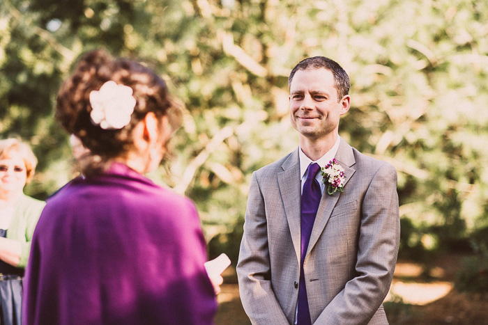 groom listening to bride's vows