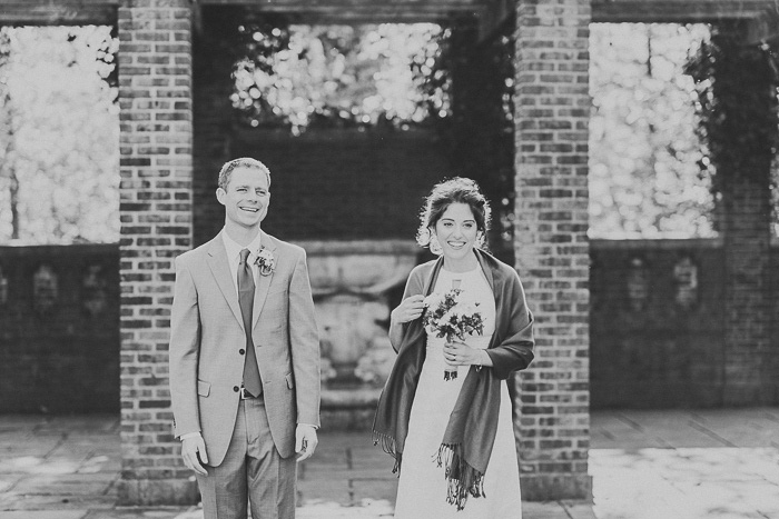 bride and groom facing guests