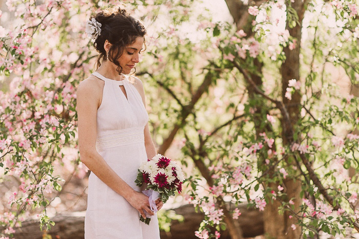 bride portrait in front of flowering tree