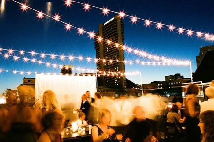 nighttime rooftop reception